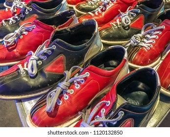 Worn bowling shoes for rent in bowling alley.
