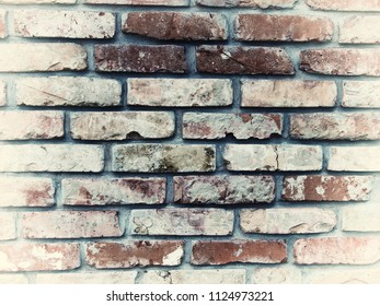 Worn brick wall pattern with pastel colored frame. Stylish texture for web background, poster design, art print.