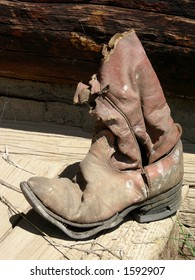 Worn cowboy boot found in historic log cabin