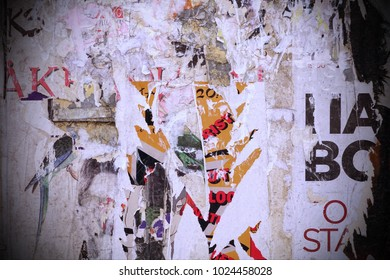 Worn Crumpled Paper Placard Texture For Design. Urban  Playbill With Ripped Ads. Old Billboard Background With Grunge Ripped Torn Vintage Collage Posters.