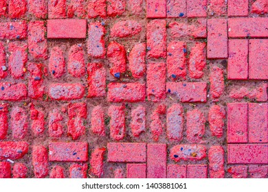 Worn footpath walk textured in red brick blocks floor above view. Red rectangle shape clay tile floor pattern. Clay brick pavement. A Worn footpath textured