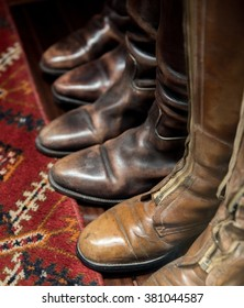 Worn Leather Boots with Patterned Carpet - Shutterstock ID 381044587