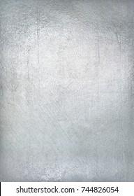 Worn metal plate steel background. Silver foil.