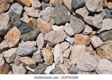 worn mixed igneous cobble rock background texture