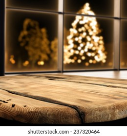 worn old table top and xmas tree in night