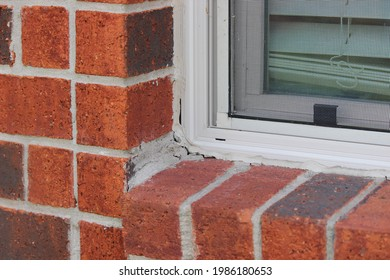Worn out caulking around the window pane. Dried off caulking that needs to be replaced.