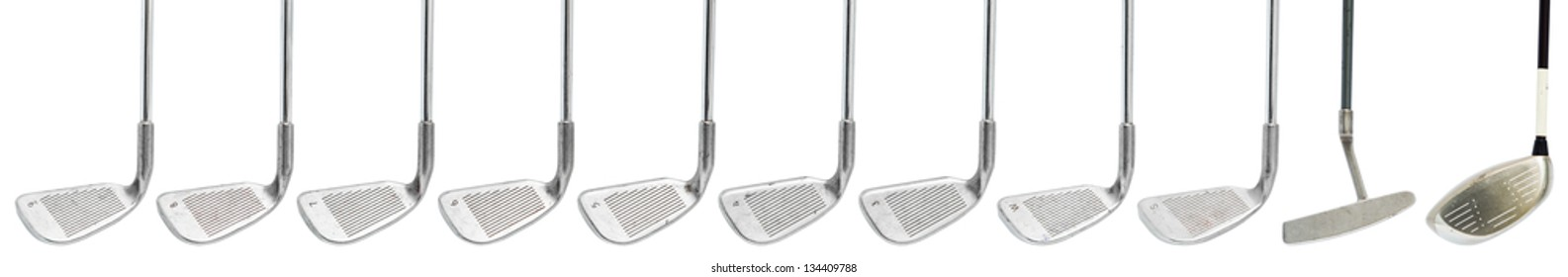 worn out golf clubs on white background