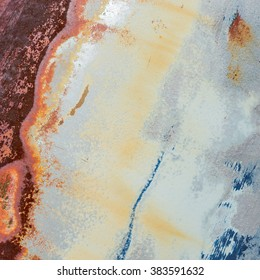 Worn painted rusty metal surface as background image
