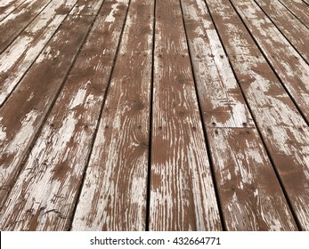 Worn and peeling deck stain wooden boards.