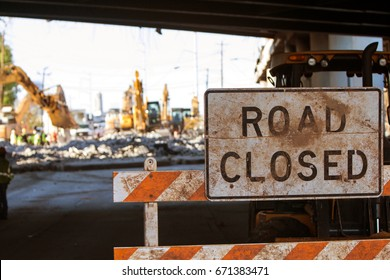 Worn Road Closed barricade blocks road at Atlanta collapsed interstate bridge construction site.