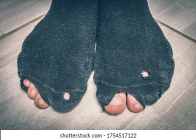 Worn socks with a holes and a toes sticking out of them - economic crisis concept - retro style
