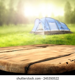 worn table and tent of blue