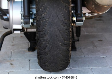A worn tyre on a motorcycle is dangerous