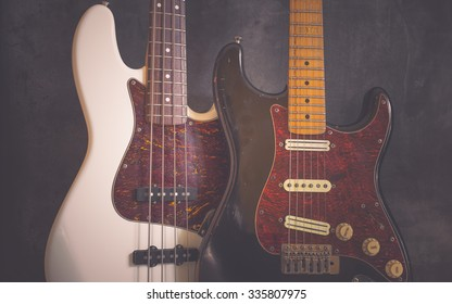 Worn vintage electric guitar and bass