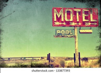 A worn vintage photo of an abandoned motel in Arizona.