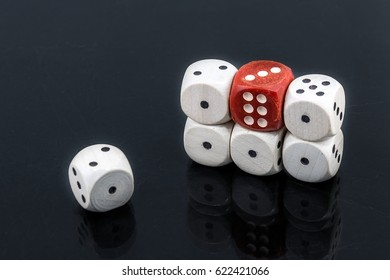 Worn white dices on a black glossy background