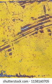 Worn yellow paint on metal sheet texture background