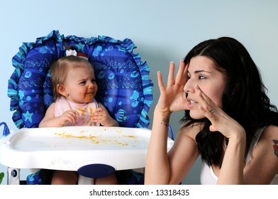 Worn-out mother with crying baby 2