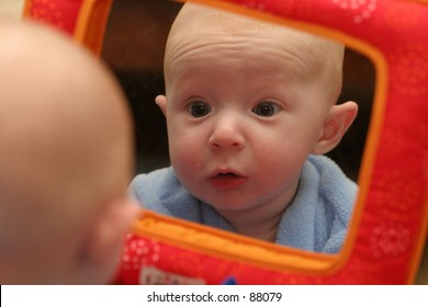 Worried baby in reflection