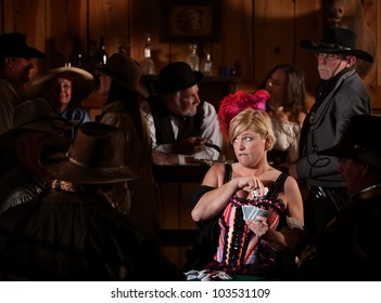 Worried bar maid pulls playing cards from bra in tavern