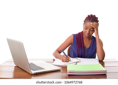 worried beautiful business woman working with a laptop on a desk, isolated on white background