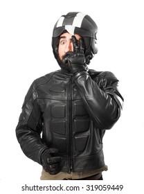 worried biker covering face