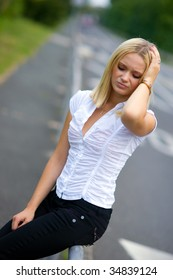 worried blonde woman on the street