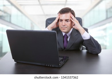 worried business man working with is laptop at the office
