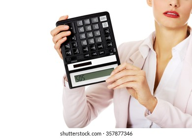 Worried business woman shows sos on calculator.