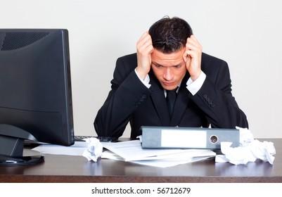 Worried businessman with paperwork stressful businesslife