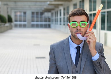 Worried businessman with scuba diving equipment