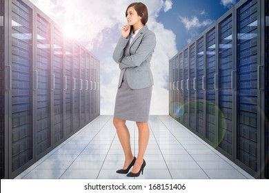 Worried businesswoman against server hallway in the sky