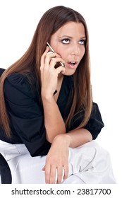Worried businesswoman speaking by phone isolated on white.