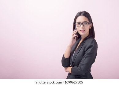 Worried businesswoman talking on phone for communication with clients about job in the office.