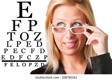 Worried bussinesswoman with glasses looking at an eyechart, isolated in a white background