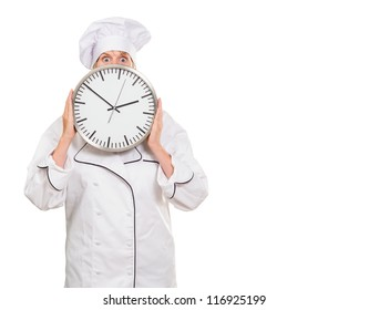 worried chef hiding behind a clock against a white background
