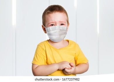 worried child wearing a protective face mask to prevent corona virus infection or pollution.