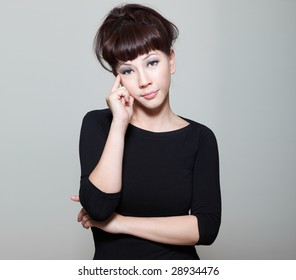 Worried chinese young woman with a contemplative expression looking into camera