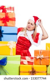 Worried Christmas woman looking at many presents, isolated on white background.