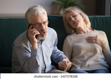 Worried desperate elder senior man husband in panic talking on phone calling 911 emergency ambulance for rescue mature old woman unconscious wife touching chest having heart attack accident at home