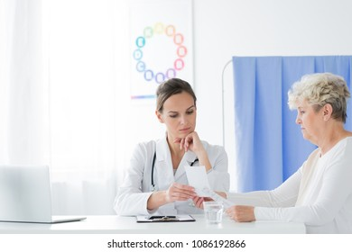 Worried doctor and her patient sitting in an office and talking about a prescription