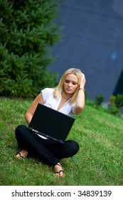 worried girl with laptop outside