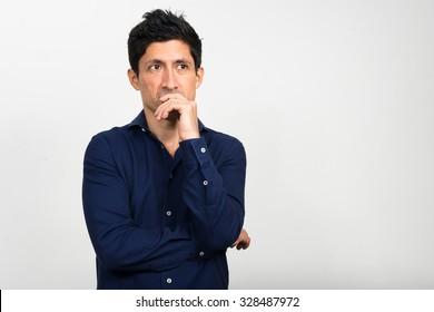Worried Hispanic man