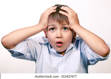 Worried kid grabbed his head with his hands