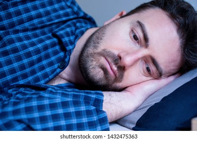 Worried man can't sleep thinking about problems