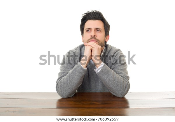 worried man on a desk, isolated on white background