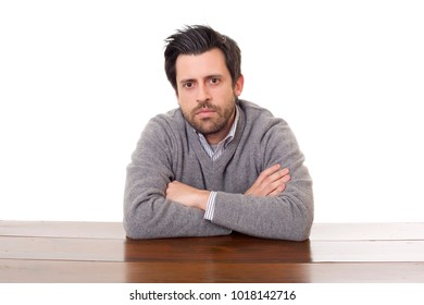 worried man on a desk with a tablet pc, isolated
