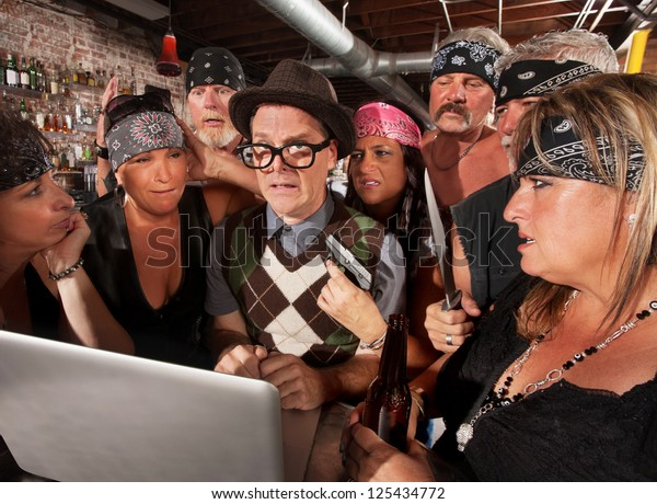Worried nerd on laptop with suspicious motorcycle gang