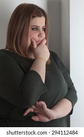 worried overweight woman portrait