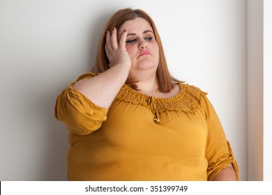 Worried overweight woman portrait